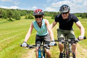 Sport mountain biking - man pushing young girl